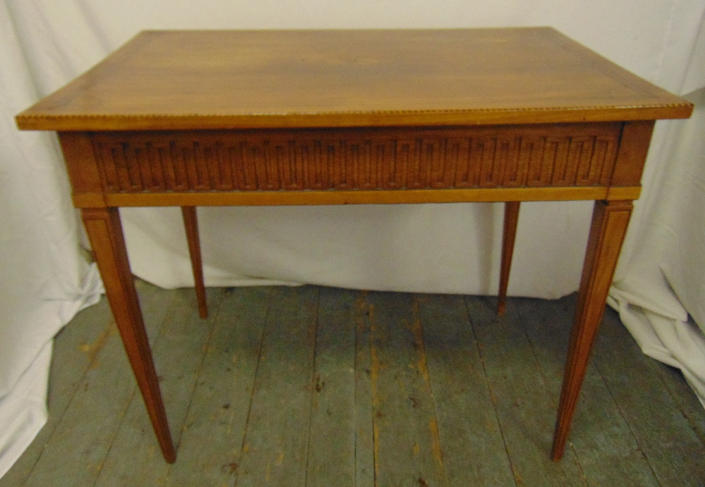 Lot 7 - An Edwardian mahogany rectangular desk on four tapering rectangular legs