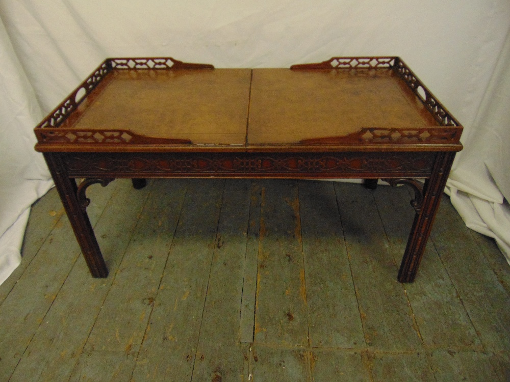 Lot 23 - A Chinese style rectangular coffee table with pierced gallery and leather top opening to reveal a