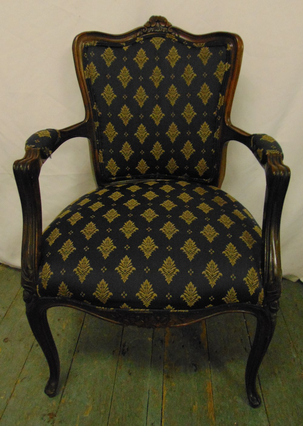 Lot 32 - A French style upholstered mahogany armchair on cabriole legs