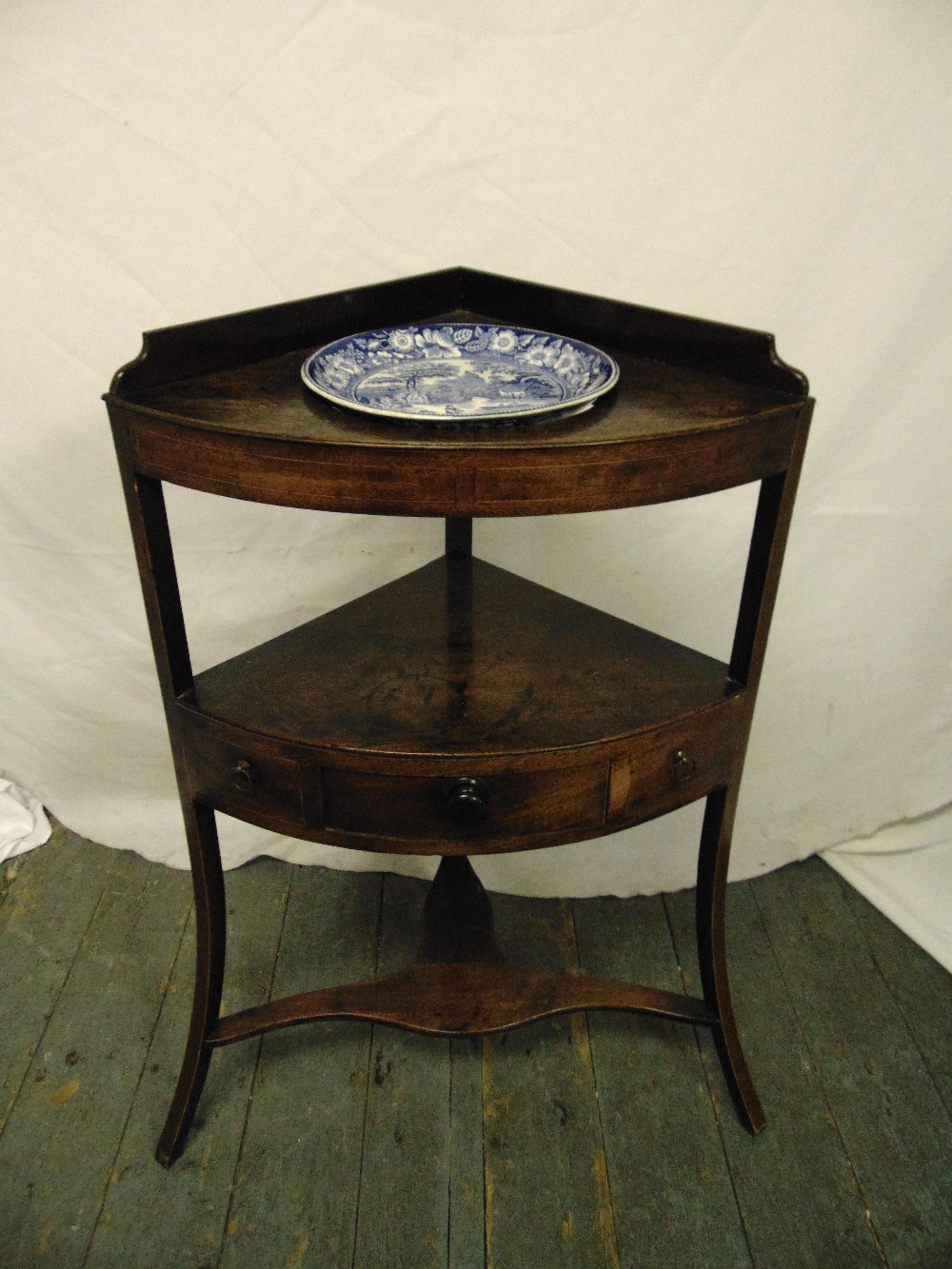 Lot 21 - A Victorian mahogany corner unit with single drawers on three outswept legs