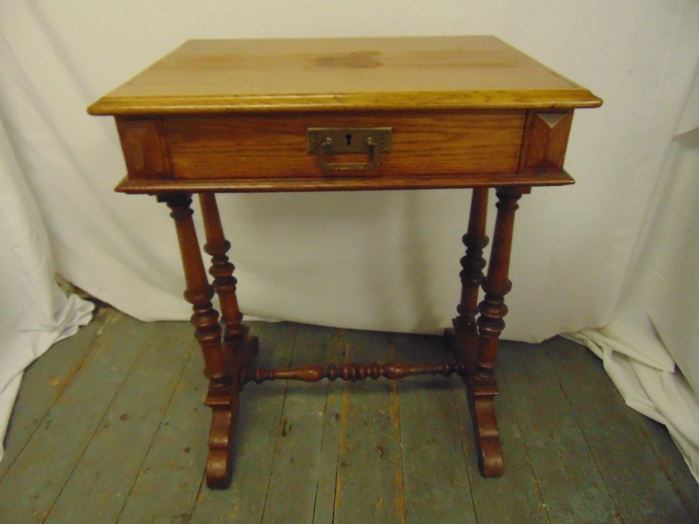 Lot 5 - A Victorian oak rectangular side table, single drawer with brass handle on four turned supports