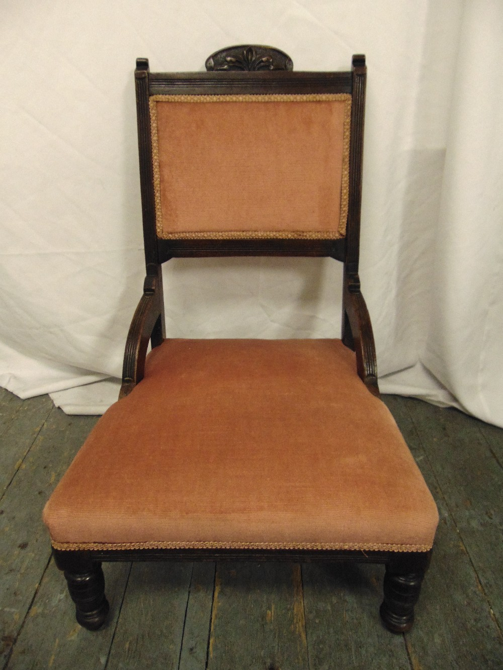 Lot 25 - An Edwardian mahogany upholstered nursing chair on turned cylindrical legs