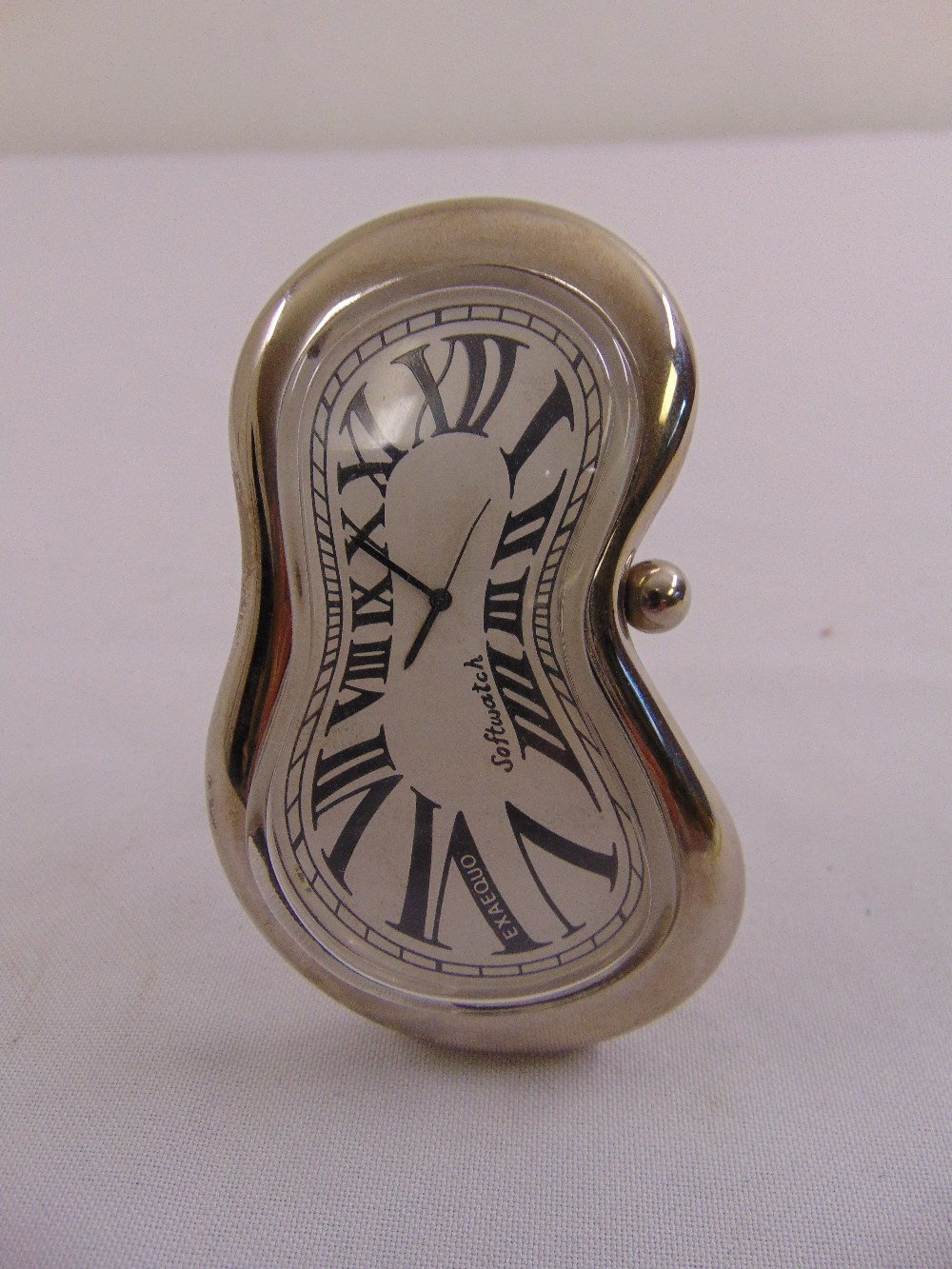 Lot 319 - Salvador Dali inspired softwatch desk watch in silver plated frame with hinged back strut by
