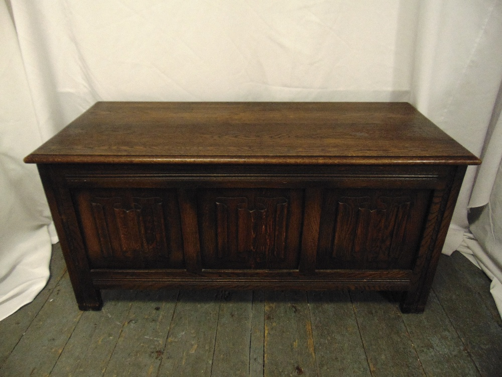 Lot 33 - A rectangular oak blanket box with hinged cover on bracket feet
