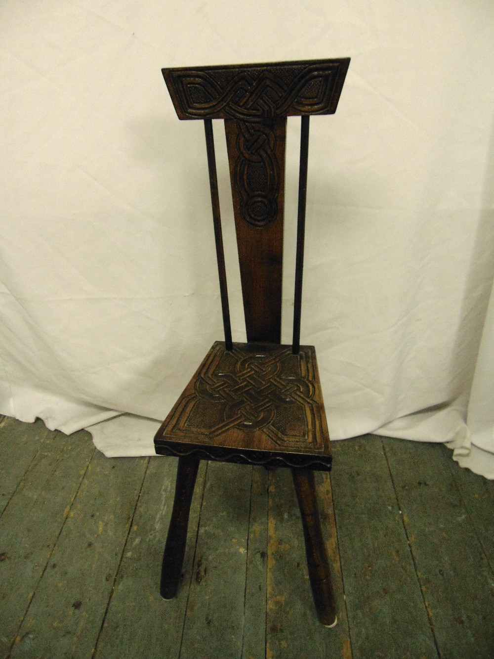 Lot 29 - A Victorian oak milking chair with T-form geometric back, carved seat and cylindrical legs