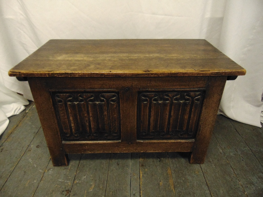 Lot 35 - A rectangular oak blanket box with hinged cover and linen fold panels on bracket feet