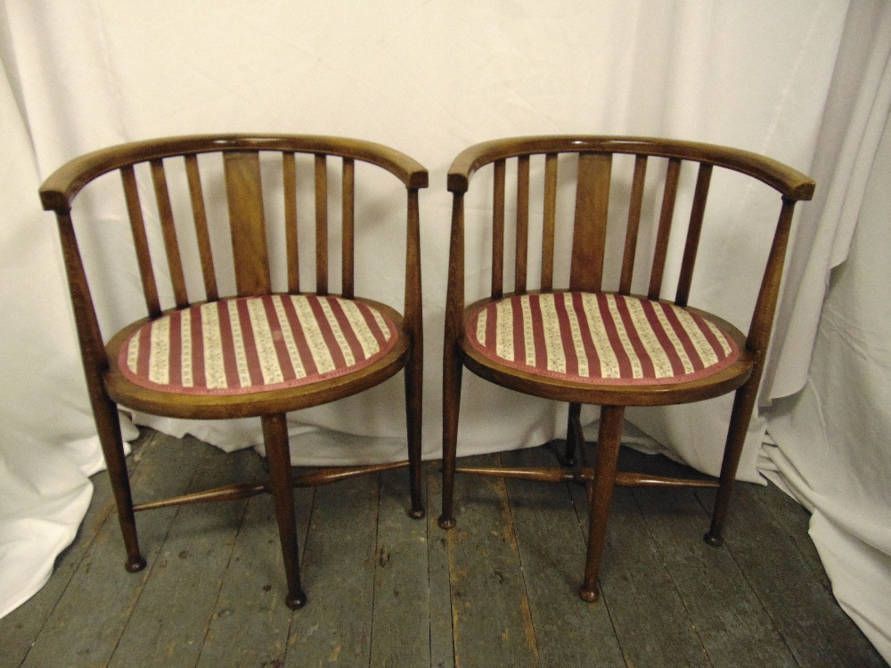 Lot 23 - A pair of Edwardian oval inlaid mahogany occasional chairs on tapering cylindrical legs