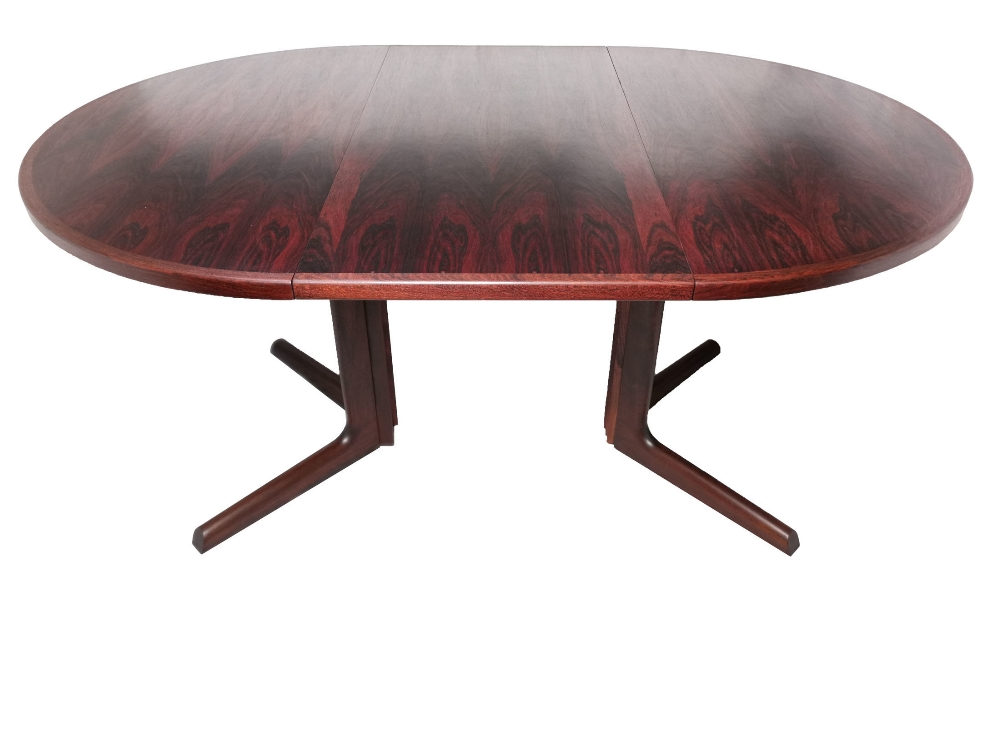 Lot 15 - A mid 20th century Rosewood circular pedestal dining table by Gudme M›belfabrik of Denmark on