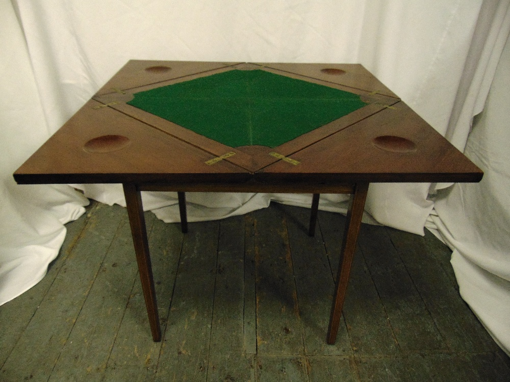 Lot 2 - An Edwardian oak square envelope card table with single drawer on four tapering rectangular legs