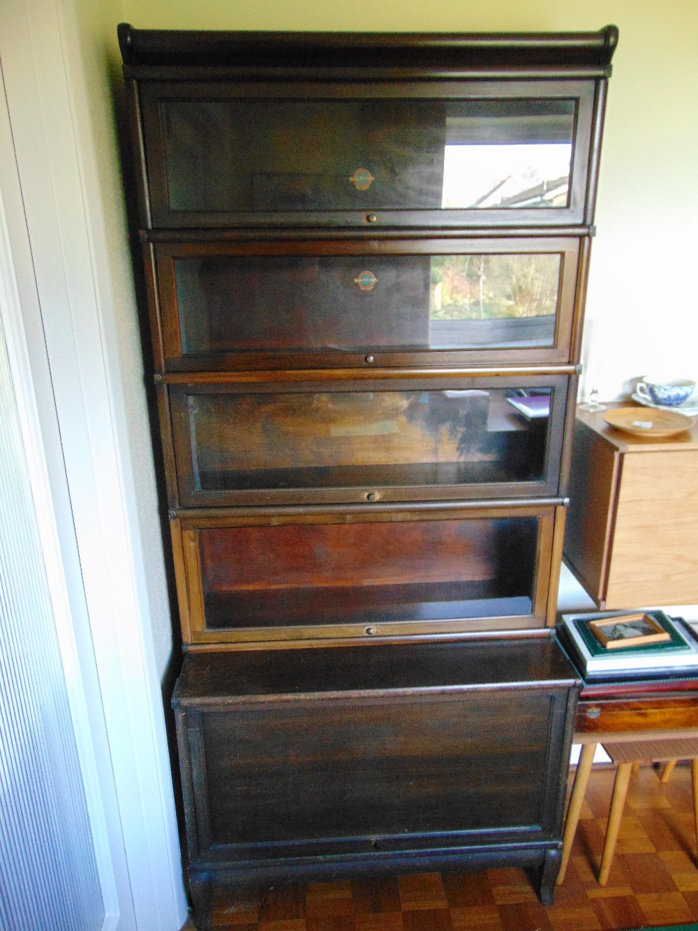Lot 1 - An original Globe Wernicke to include glazed shelves above a rectangular cupboard on four legs