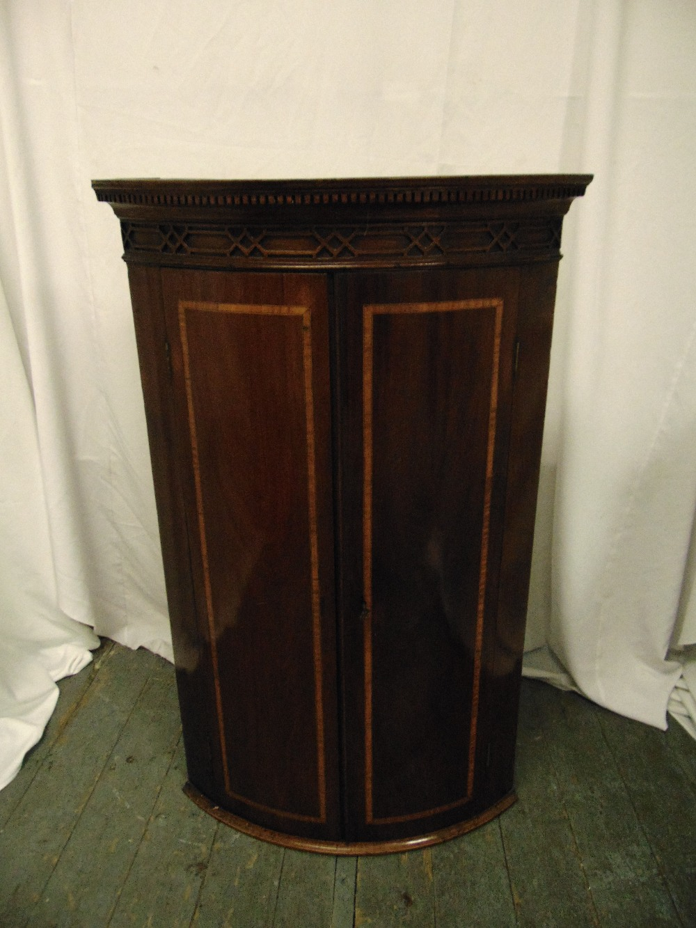 Lot 8 - A 19th century mahogany inlaid wall mounted corner cabinet with hinged doors