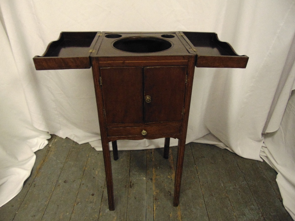 Lot 19 - An early 20th century rectangular mahogany wash cabinet with hinged top and cupboard doors on four