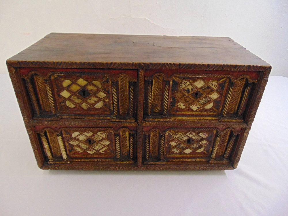 Lot 11 - Indo-Portuguese rectangular cabinet, the four drawers carved with free standing columns and inset