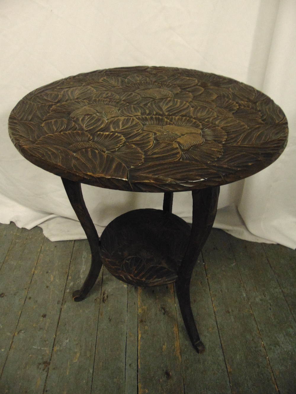 Lot 17 - An oriental circular side table on three outswept legs