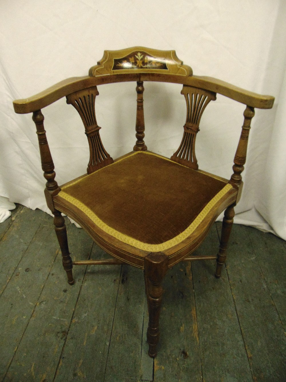 Lot 26 - An Edwardian mahogany corner chair with pierced slats on four turned legs