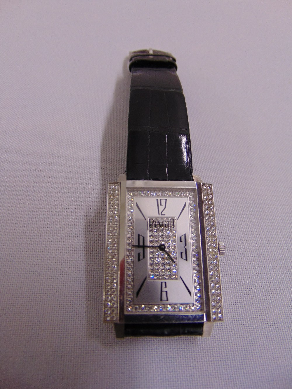 Lot 322 - Piaget Mecanique 750 wristwatch set with diamonds to the face and bezel with Piaget leather and gold