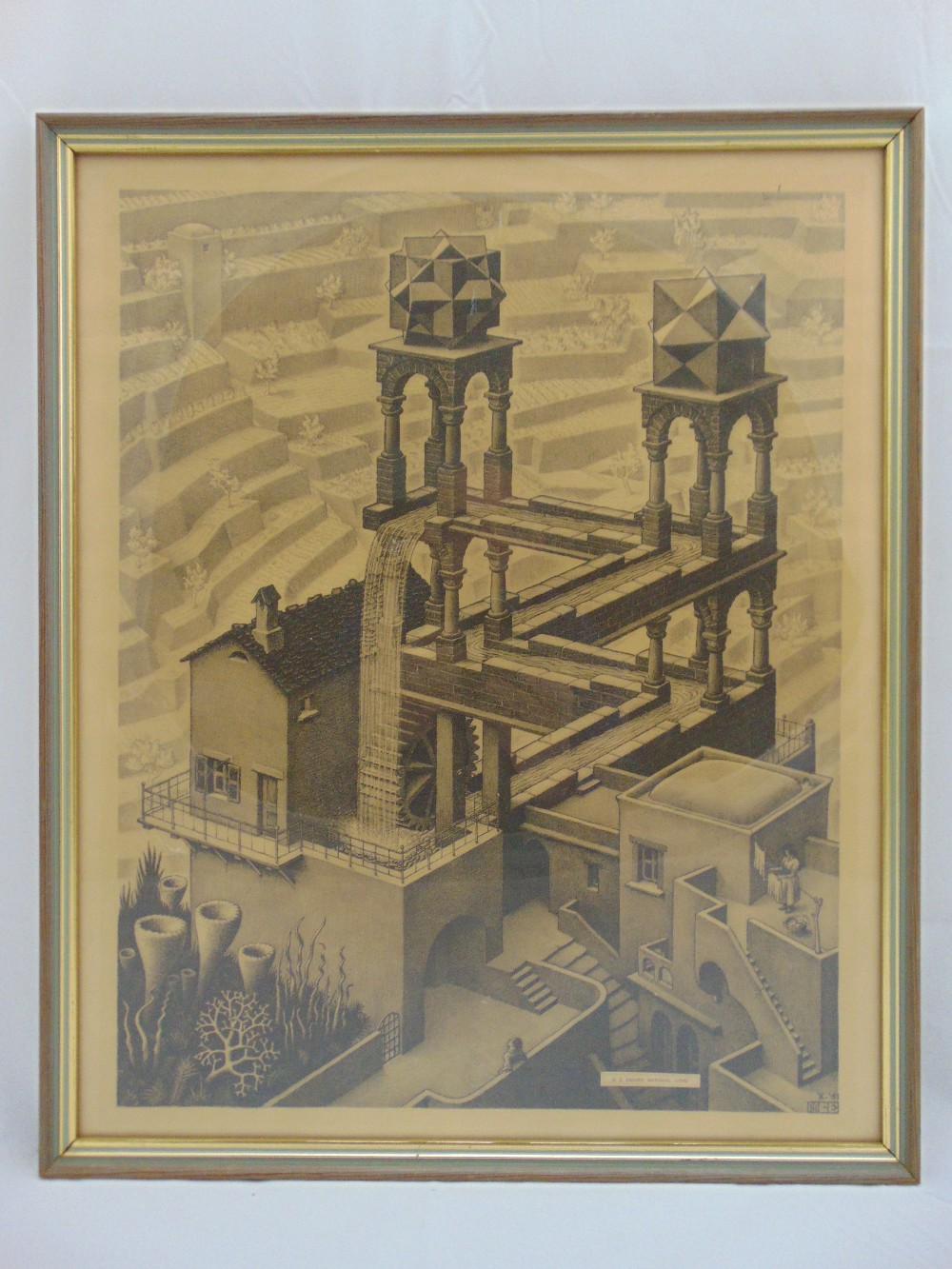 Lot 35 - M. S. Escher framed and glazed monochromatic etching titled Waterfall, 51 x 40cm