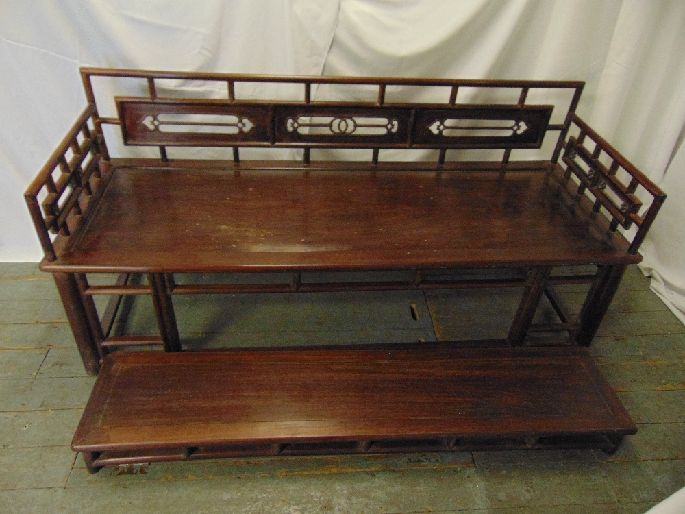 Lot 2 - Chinese rectangular hardwood daybed with pierced carved back and matching footstool