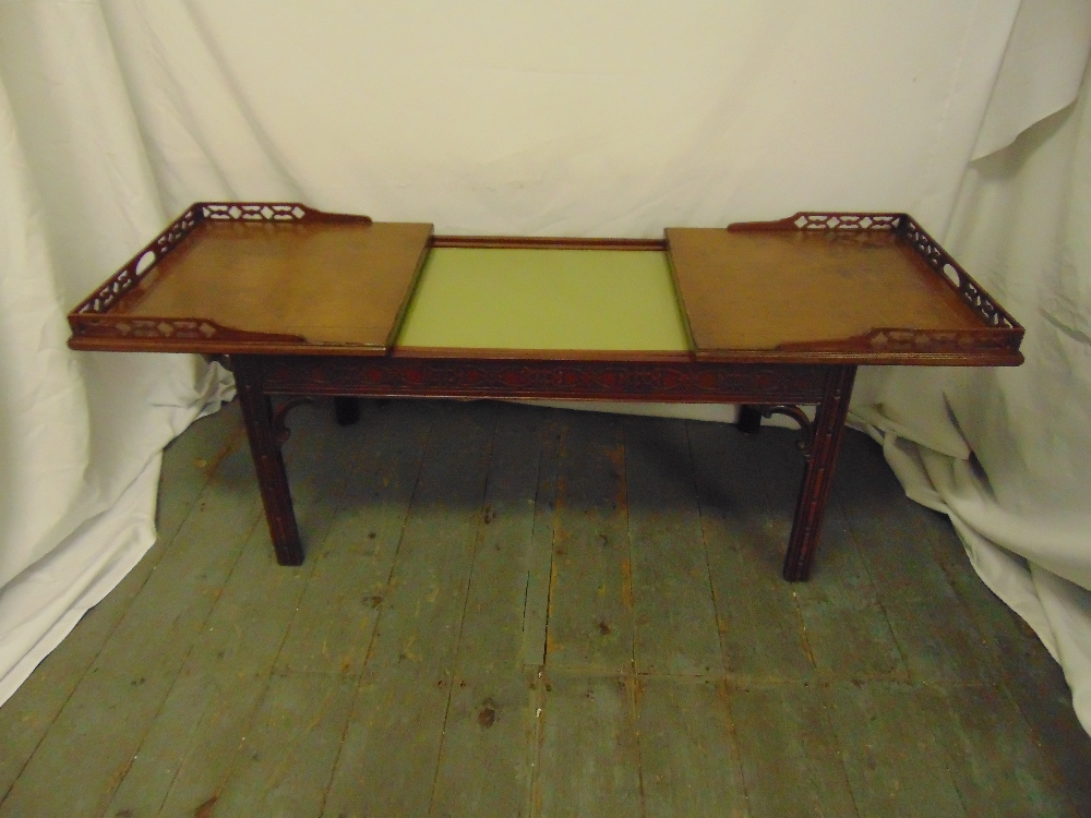 Lot 4 - A Chinese style rectangular coffee table with pierced gallery and leather top opening to reveal a