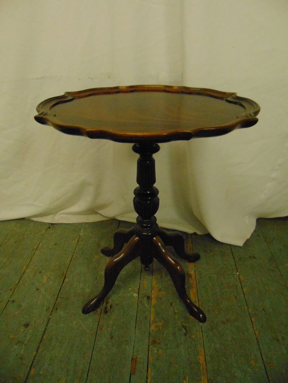 Lot 14 - A mahogany wine table with moulded border, baluster stem and four scroll legs