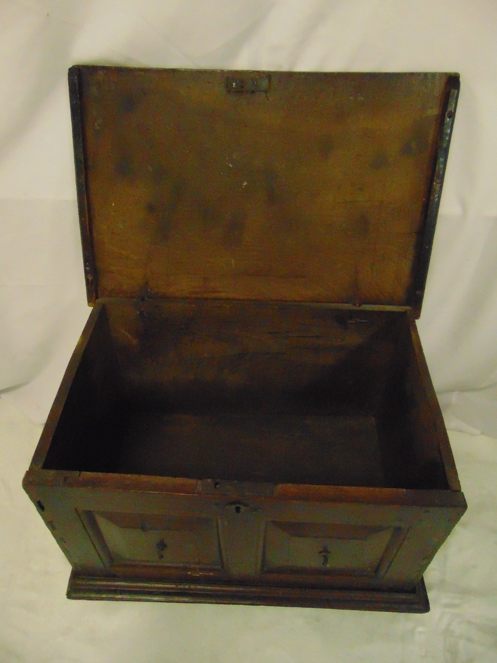Lot 12 - A rectangular oak blanket box with panelled sides and hinged cover