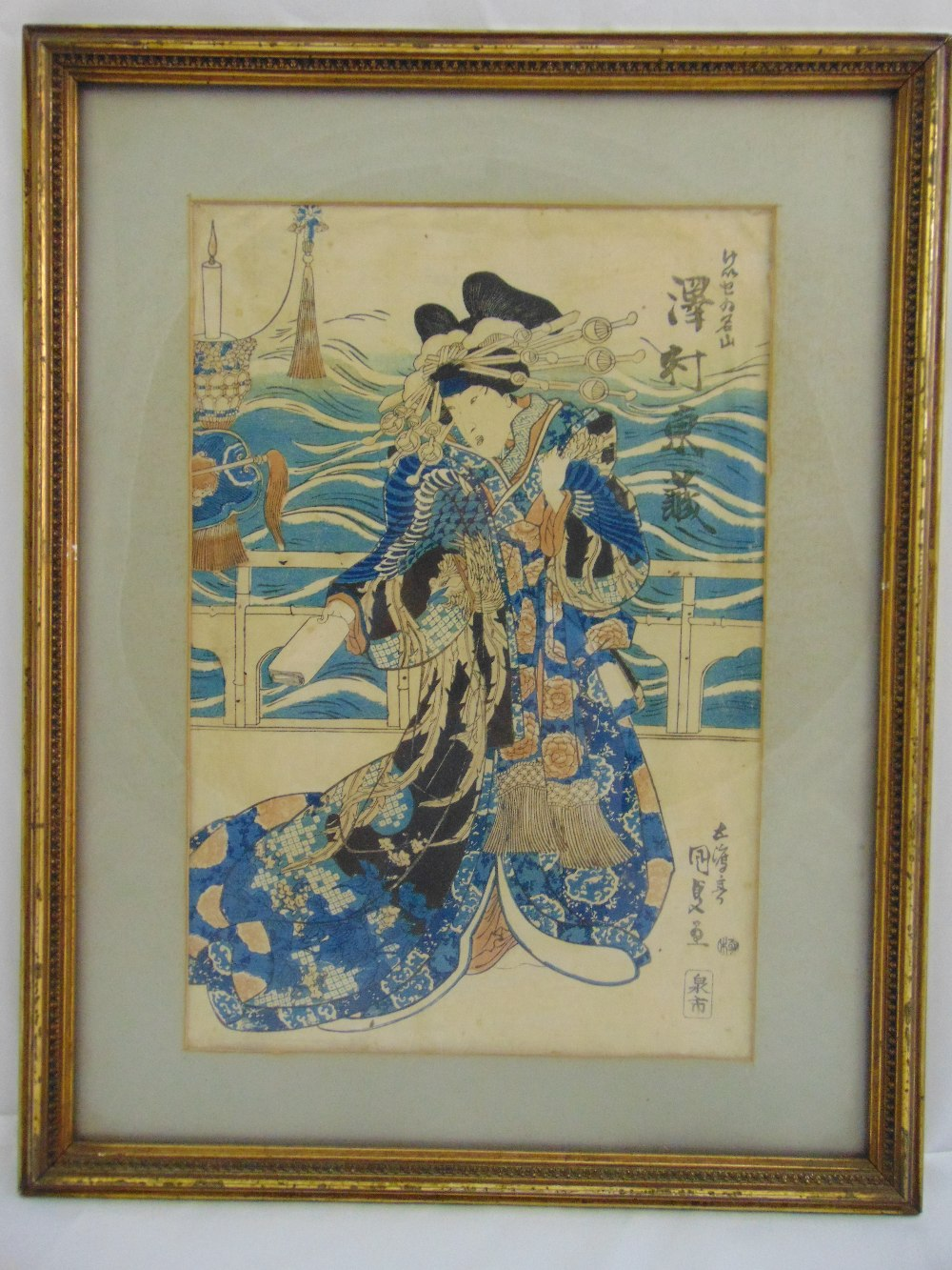 Lot 37 - A framed Japanese polychromatic etching of a Geisha, signed top and bottom to the right, 36.5 x 24.