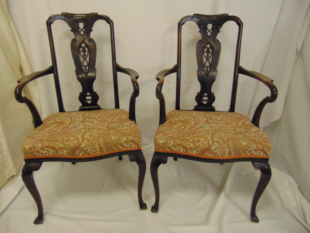 Lot 19 - A pair of Victorian mahogany armchairs in 18th century style, pierced splats on cabriole legs