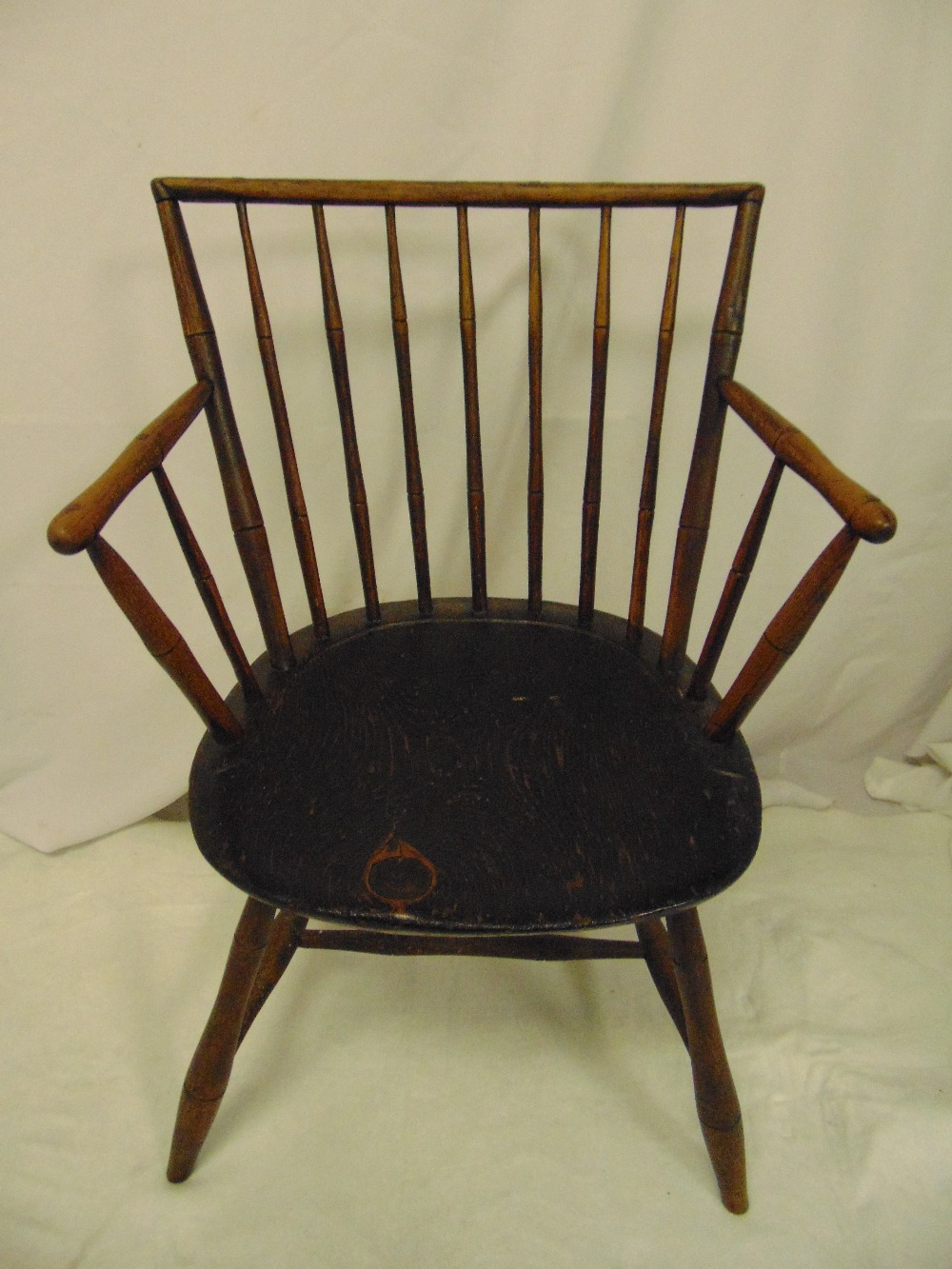Lot 22 - An early oak spindle back chair on four turned cylindrical legs