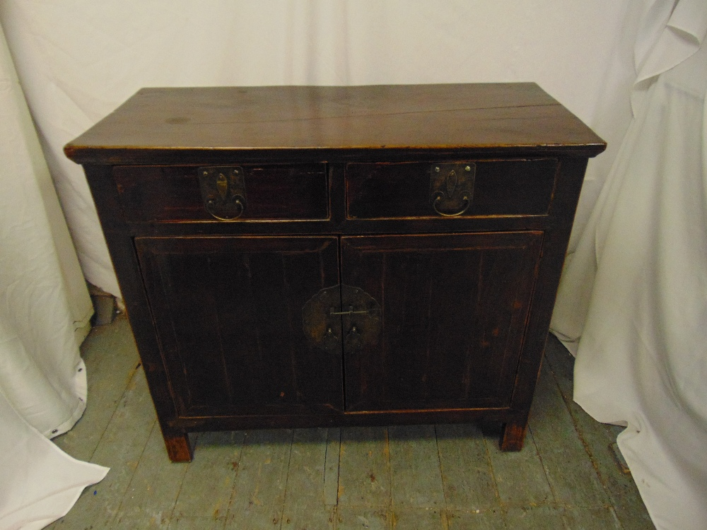 Lot 3 - An Oriental rectangular hardwood cabinet with drawers and cupboards on four bracket feet