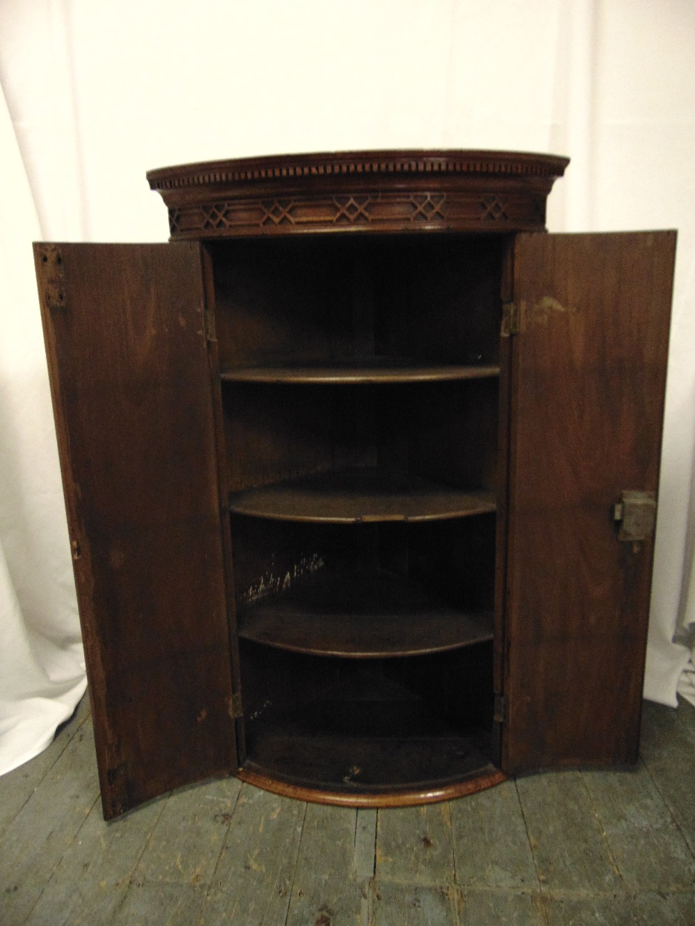 Lot 6 - A mahogany inlaid wall mounted corner cabinet with hinged doors