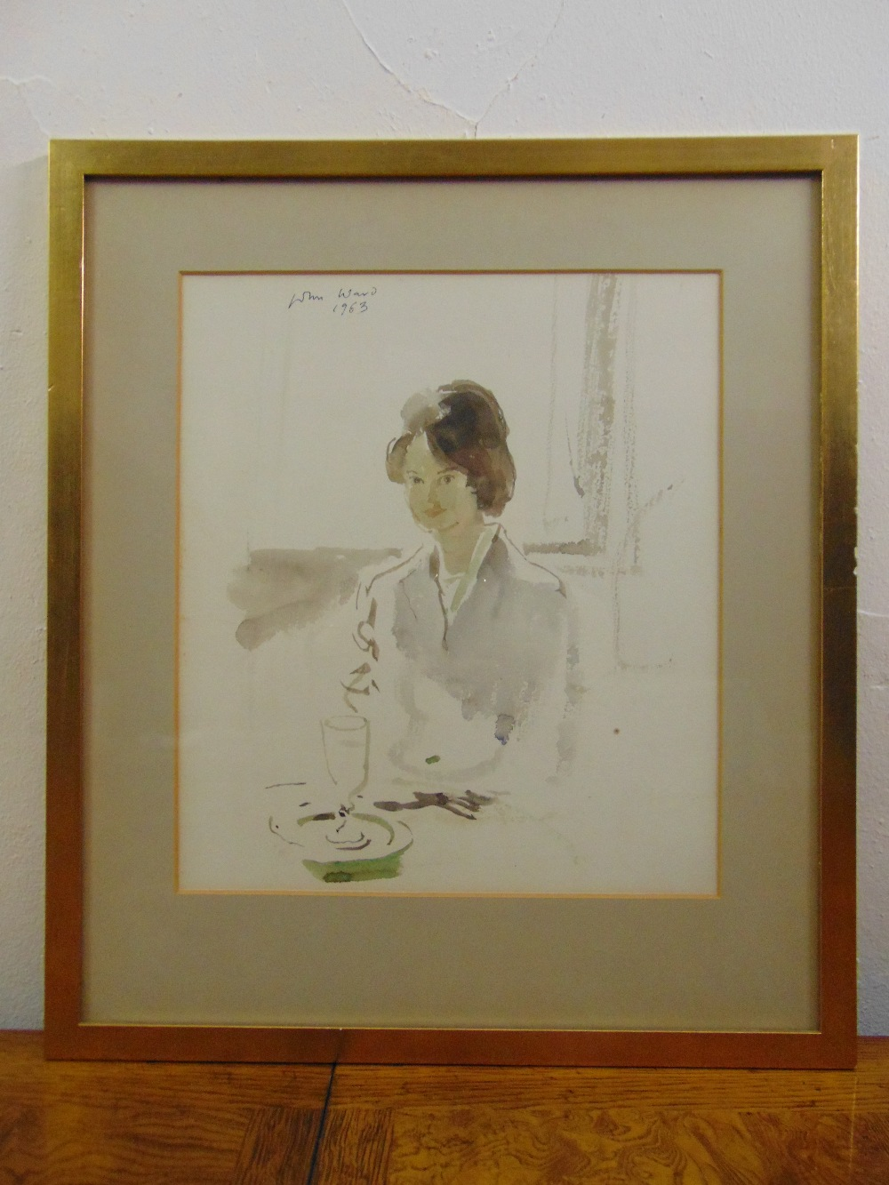 Lot 42 - John Stanton Ward 1917-2007 framed and glazed watercolour of a lady seated at a table, signed and