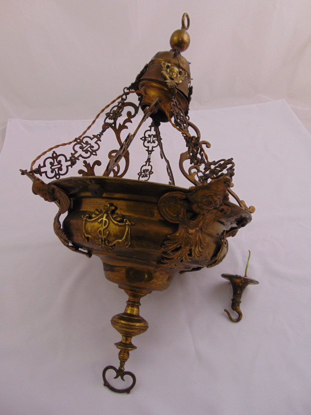 Lot 27 - A 19th century brass chandelier of circular form with applied decoration, eight pierced suspensory