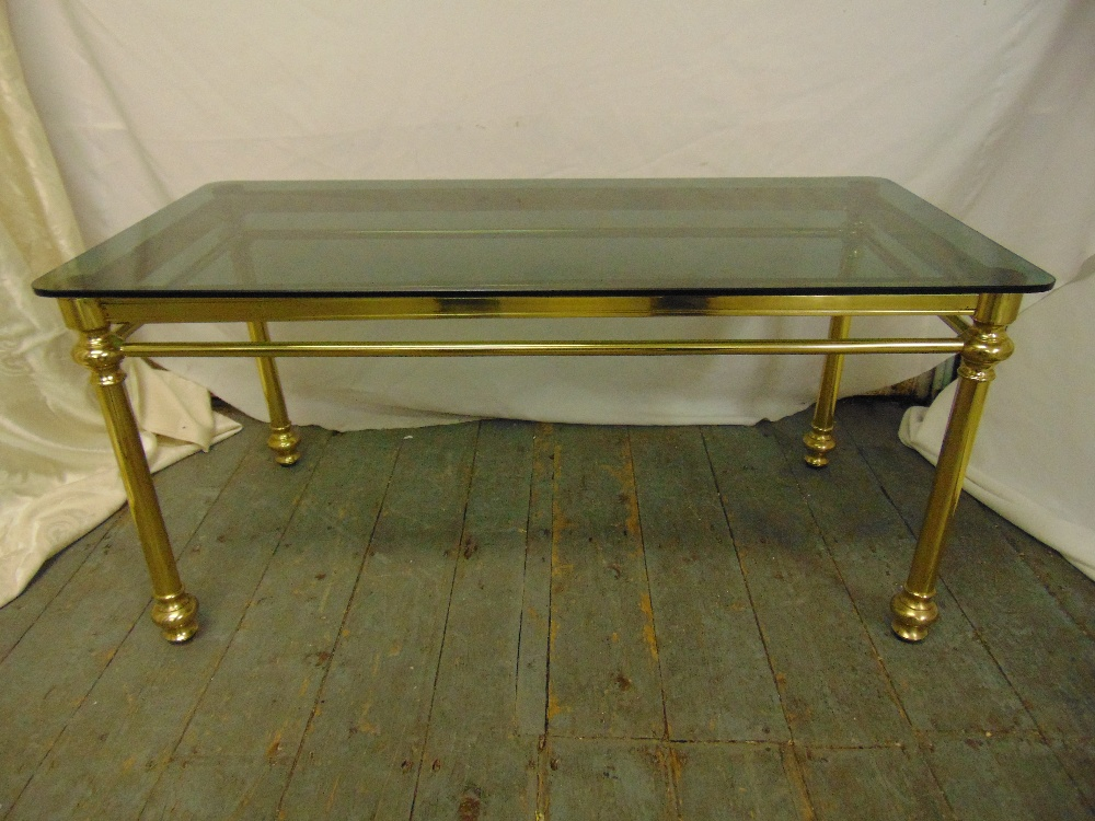 Lot 15 - A gilded metal and glass rectangular coffee table