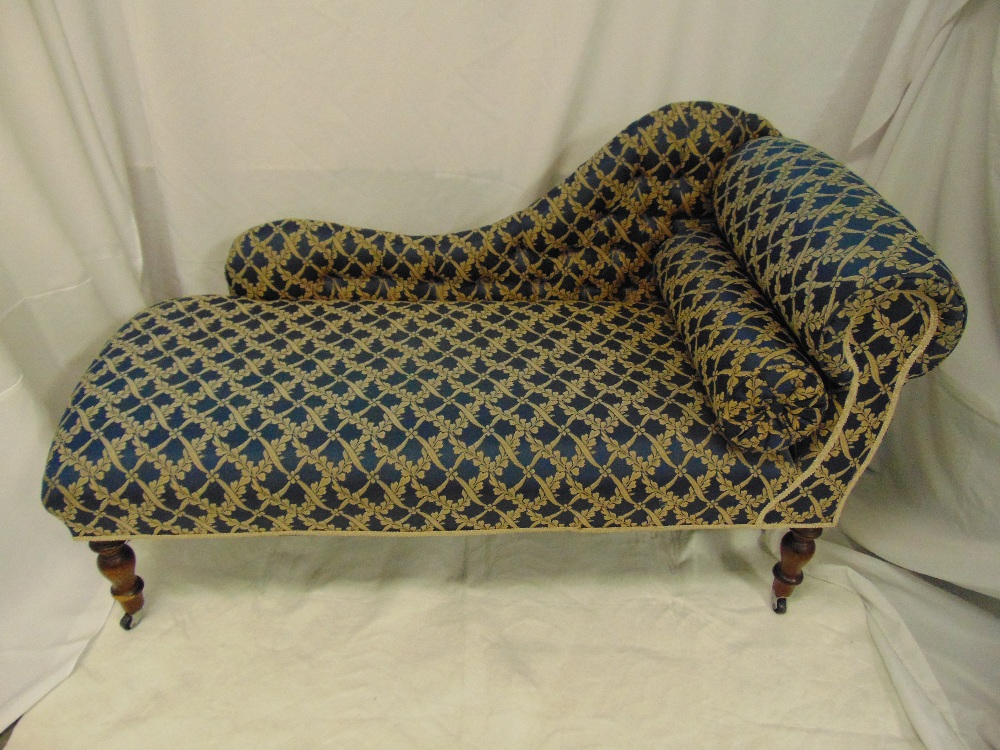 Lot 18 - A Victorian chaise longue of customary form on turned mahogany legs