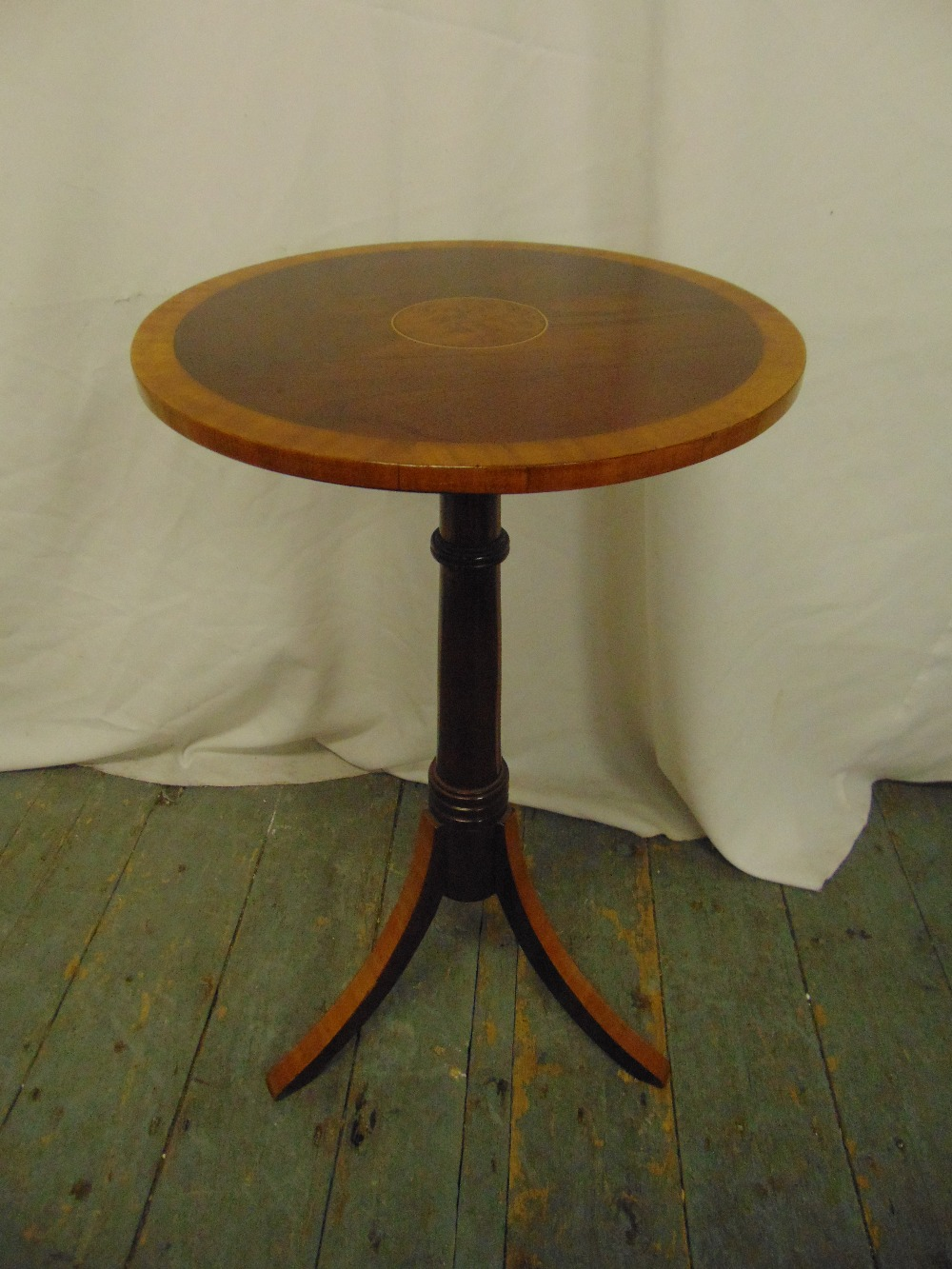 Lot 13 - A mahogany circular side table on three outswept legs