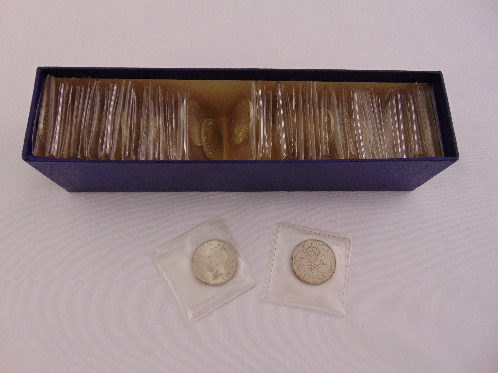 Lot 393 - Sixty seven 1946 George VI florins all in individual plastic sleeves, approx total weight of coins