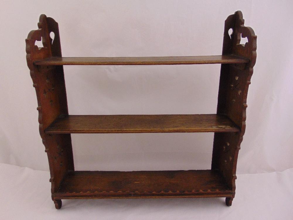 Lot 24 - A rectangular mahogany wall mounted shelf