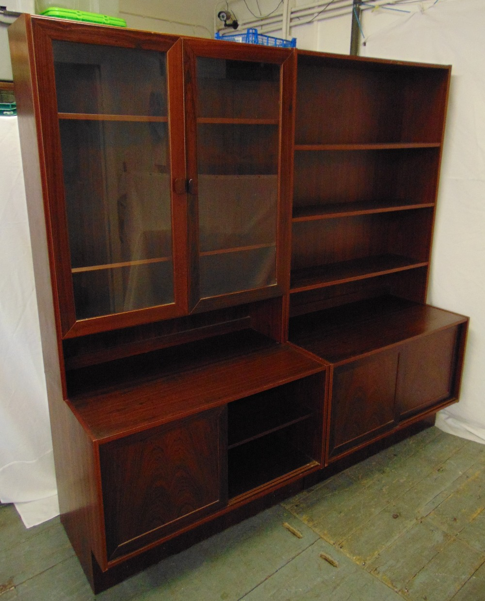 Lot 5 - Danish rosewood rectangular wall unit to include two base units with cupboards, a glazed top section