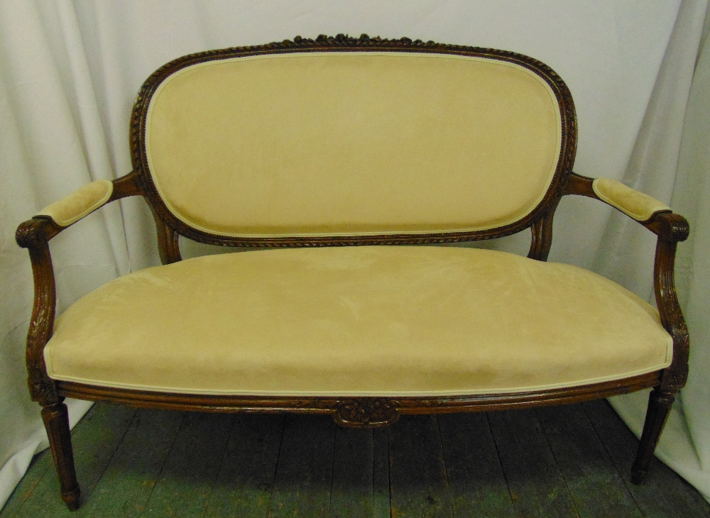 Lot 21 - A Victorian mahogany two seater upholstered sofa on turned tapering legs, 95 x 127 x 71cm