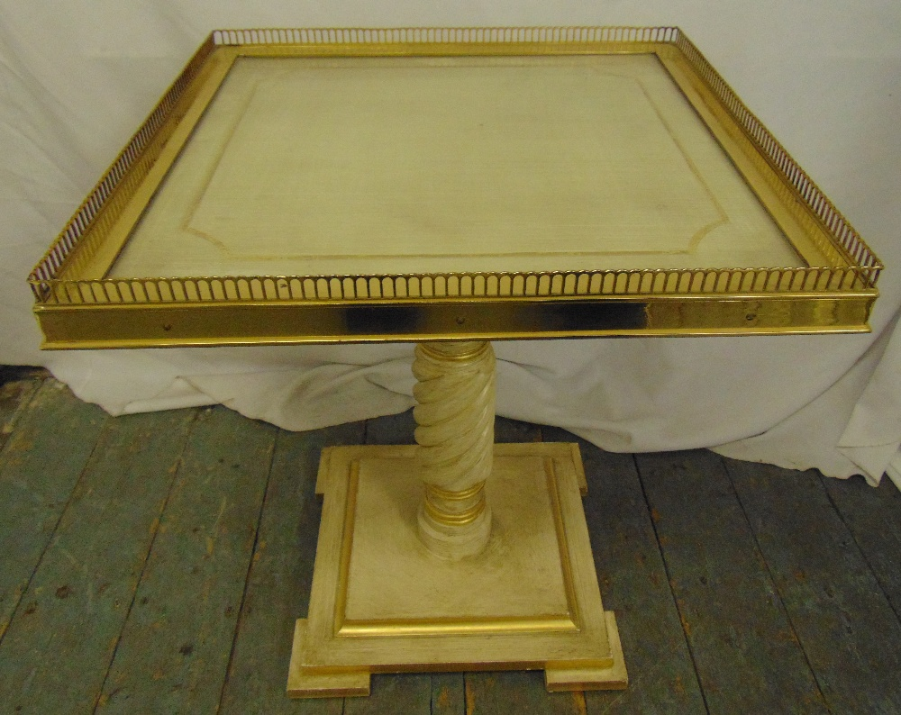 Lot 20 - A rectangular gilt metal and painted wooden side table with pierced gallery on raised square base,