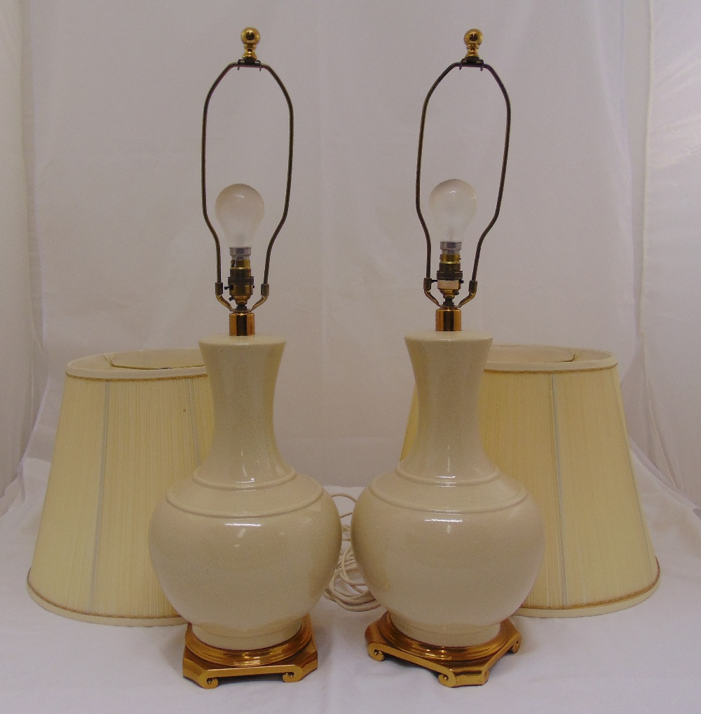 Lot 39 - A pair of porcelain baluster form table lamps to include shades, 76cm (h)