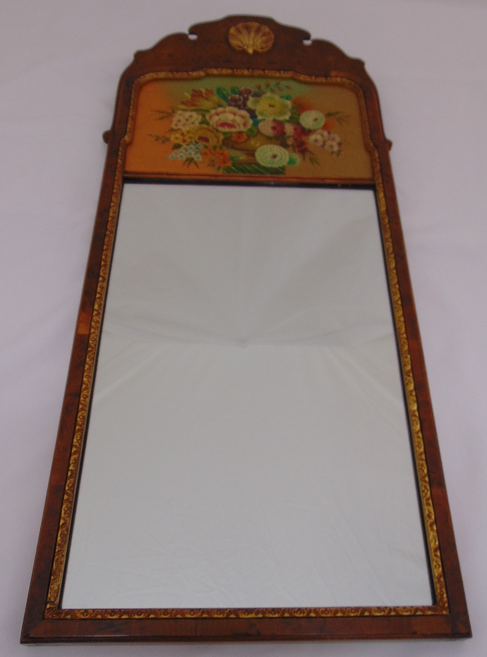Lot 28 - A rectangular wall mirror in 18th century style, the top painted with flowers and leaves, 79.5 x