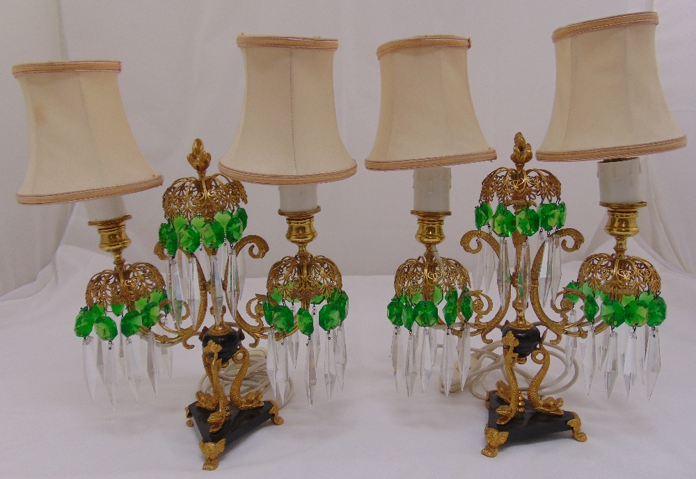 Lot 32 - A pair of two light glass and gilded metal candelabra table lamps with crystal drops and silk