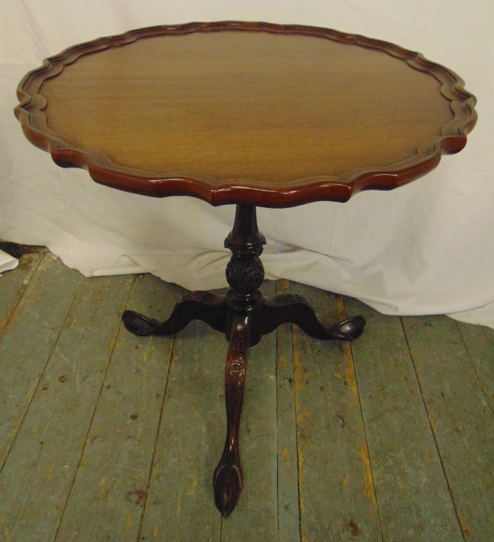 Lot 11 - A Victorian mahogany tilt top piecrust wine table on three outswept legs, 64cm (h) 62cm (dia)