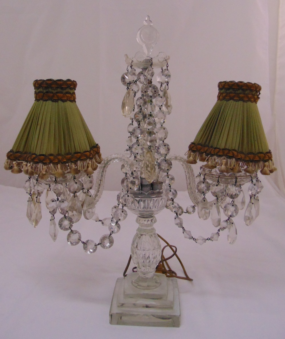 Lot 31 - A 19th century crystal two branch lamp stand with crystal drops on stepped square base,