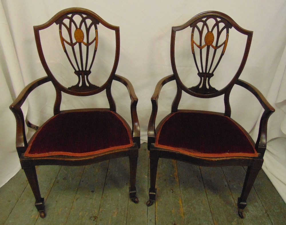 Lot 22 - A pair of Hepplewhite style mahogany upholstered carvers, one A/F