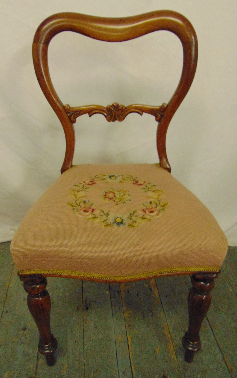 Lot 24 - A Victorian mahogany balloon back chair with upholstered seat on turned legs