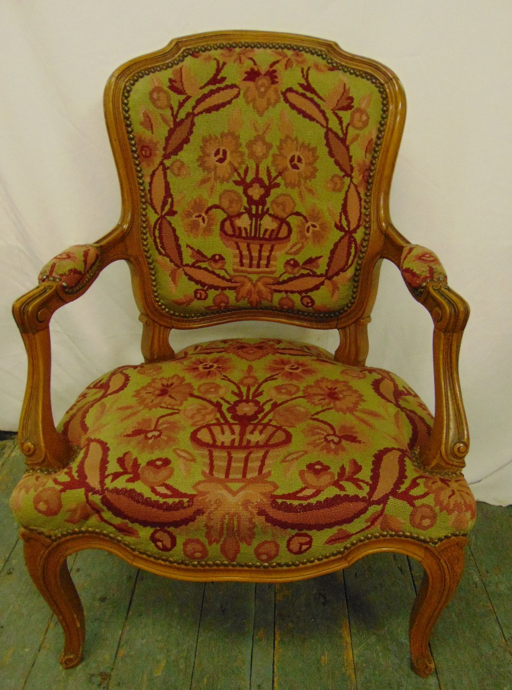Lot 23 - A mahogany armchair with upholstered tapestry seat and back on cabriole legs
