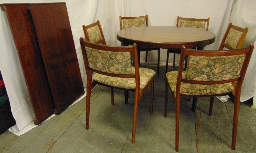 Lot 4 - Danish rosewood circular dining table with drop in leaves and six matching upholstered dining chairs