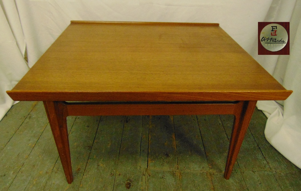 Lot 18 - A rectangular 1970s teak coffee table, on four tapering rectangular legs, makers label to